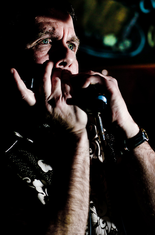 """Mike Mettalia of Midnight Shift, on harmonica and vocals, during the """"April Mae & Catfish Get Outta Town Party"""" at Red Hot & Blue."""