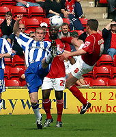 Photo: Dave Linney.<br />Walsall v Huddersfield Town. Coca Cola League 1. 22/04/2006Walsall's (R) in high kicking action with  Andy Booth
