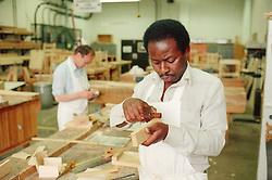 Carpenter joiner at work using tools in workshop,