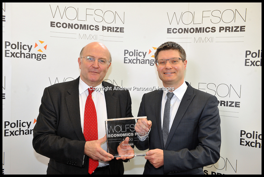 Roger Bootle from Capital Economics (red Tie,glasses) wins the Wolfson Economics Prize presented by Lord Wolfson (right), Thursday July 5, 2012. Photo by Andrew Parsons/i-Images.All Rights Reserved ©Andrew Parsons/i-Images.See Instructions