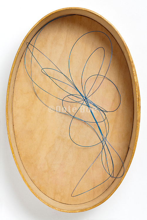 wooden oval box with fishing line