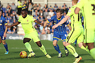 Dannie Bulman of AFC Wimbledon and Hartlepool United striker Kudus Oyenuga battle during the Sky Bet League 2 match between AFC Wimbledon and Hartlepool United at the Cherry Red Records Stadium, Kingston, England on 31 October 2015. Photo by Stuart Butcher.