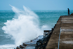 © Licensed to London News Pictures. 03/11/2018. Aberystwyth, UK. Winds gusting up to 60mph and stormy seas bring waves crashing into Tanybwlch beach and harbour walls in Aberystwyth as the tail end of Hurricane Oscar sweeps across the north and the west of the UK this weekend. .Photo credit: Keith Morris/LNP