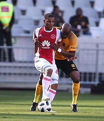 Cape Town-180512   Kaizer Chiefs  defender Ramahlwe Mphahlele challenges  Fagrie Lakay   of Ajax Cape Town in the last game of the PSL at Cape Town stadium.photographer:Phando Jikelo/African News Agency/ANA