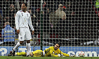 Photo: Paul Thomas/Sportsbeat Images.<br />England v Croatia. UEFA European Championships Qualifying. 21/11/2007.<br /><br />Dejected Scott Carson (Yellow) and Joleon Lescott (5) of England after Croatia score there third goal.