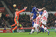 Daniel Amartey of Leicester City heads the ball to score his teams 2nd goal. Premier league match, Stoke City v Leicester City at the Bet365 Stadium in Stoke on Trent, Staffs on Saturday 17th December 2016.<br /> pic by Chris Stading, Andrew Orchard sports photography.
