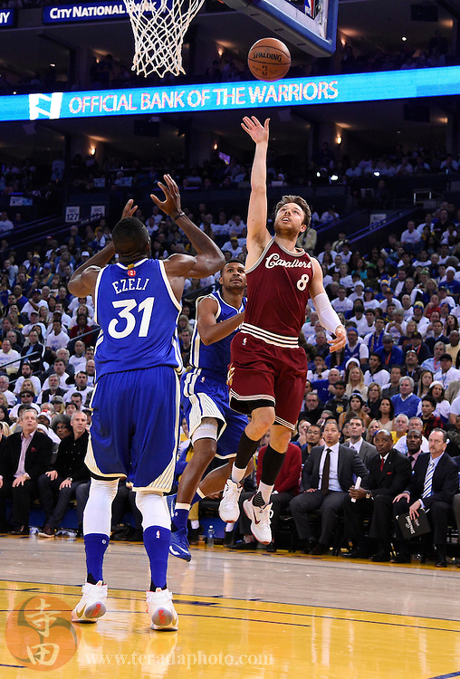 Dec 25, 2015; Oakland, CA, USA; Cleveland Cavaliers guard Matthew Dellavedova (8) shoots against Golden State Warriors center Festus Ezeli (31)  in the first half of a NBA basketball game on Christmas at Oracle Arena.