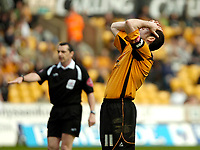 Photo: Ed Godden.<br />Wolverhampton Wanderers v Brighton & Hove Albion. Coca Cola Championship. 22/04/2006. Wolves Captain, Mark Kennedy, can't believe he just missed a close range shot.