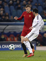 December 5, 2017 - Rome, Italy - Roma s Edin Dzeko, left, is challenged by Qarabag s Elvin Yunuszadae during the Champions League Group C soccer match between Roma and Qarabag at the Olympic stadium. Roma won 1-0 to reach the round of 16. (Credit Image: © Riccardo De Luca/Pacific Press via ZUMA Wire)