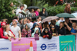 © Licensed to London News Pictures. 07/07/2014. London, UK. The crowd wait in rain near Tower Bridge ahead of the Tour de France stage 3 in London. Photo credit : Vickie Flores/LNP