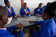 Diamond polishers play a game of dominoes during a break at NamCot Diamonds, a diamond cutting and polishing company in Windhoek, Namibia. Diamonds are one of Namibia's major exports, and  while conflict diamonds grab the headlines, the fact is that the industry does provide a fairly decent living for many.
