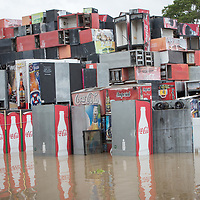 Drinks coolers are stacked in a flooded area of La Lima, Honduras after hurricanes Eta and Iota.
