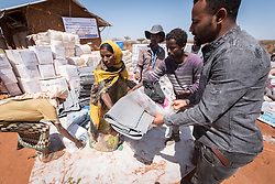 28 January 2019, Wada IDP site, near Micha kebele, Seweyna woreda, Bale Zone, Oromia, Ethiopia: LWF staff distribute IMO-sponsored non-food items at the Wada IDP site in Seweyna woreda. The Lutheran World Federation supports internally displaced people in several regions of Ethiopia, through emergency response on water, sanitation and hygiene (WASH) as well as long-term development and empowerment projects, to help build resilience and adapt communities' lifestyles to a changing climate.