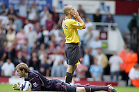 Photo: Paul Thomas.<br /> West Ham United v Arsenal. The Barclays Premiership. 24/09/2005.<br /> <br /> Arsenal's Fredrik Ljungberg can't believe he didn't beat West Ham keeper Roy Carroll.