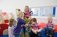 Nederland, Helmond, 20091111...Kinderdagverblijf de Bereboot is een nieuw kdv dat is gestart op een landgoed in een mooie ruime en groene omgeving. ..De juf leest voor....Netherlands, Helmond, 20091111. ..Childcare, The nursery the Bear boot is on an estate in a beautiful and spacious green surroundings.    ..