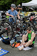 Catie Ledwick and David Dibelius (seated) during the T1 swin to  bike transition in the 2018 Hague Endurance Festival Sprint Triathlon