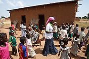 Abdulai Sadia walks among children she teaches in the community of Kunayili, near Gushegu, Northern Ghana, on Wednesday November 2, 2011.