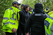 """Leicester, United Kingdom, May 20, 2021: A woman who was trying to supply food and water to """"Palestine Action"""" activists sanding on the rooftop of the Elbit subsidiary UAV Tactical Systems during a """"Stop Bombing Gaza"""" protest campaign in Leicester was restrained and arrested by the Police on Thursday, May 20, 2021. At least 232 Palestinians, including 65 children, have been killed in 11 days of Israeli bombardment. On the Israeli side, 12 people, including two children, have been killed. Israel and Hamas agreed to a ceasefire on Thursday to halt 11 days of fighting in the Gaza Strip. (Photo by Vudi Xhymshiti)"""