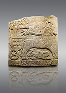 Picture & image of Hittite relief sculpted orthostat stone panel of Long Wall Limestone, Karkamıs, (Kargamıs), Carchemish (Karkemish), 900 -700 B.C. Anatolian Civilisations Museum, Ankara, Turkey<br /> <br /> Chariot. One of the two figures in the chariot holds the horse's headstall while the other throws arrows. There is a naked enemy with an arrow in his hip lying face down under the horse's feet. It is thought that this figure is depicted smaller than the other figures since it is an enemy soldier. The lower part of the orthostat is decorated with braiding motifs.<br /> <br /> On a gray background. .<br />  <br /> If you prefer to buy from our ALAMY STOCK LIBRARY page at https://www.alamy.com/portfolio/paul-williams-funkystock/hittite-art-antiquities.html  - Type  Karkamıs in LOWER SEARCH WITHIN GALLERY box. Refine search by adding background colour, place, museum etc.<br /> <br /> Visit our HITTITE PHOTO COLLECTIONS for more photos to download or buy as wall art prints https://funkystock.photoshelter.com/gallery-collection/The-Hittites-Art-Artefacts-Antiquities-Historic-Sites-Pictures-Images-of/C0000NUBSMhSc3Oo