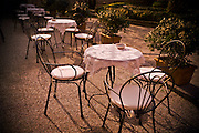 Tables are set at an outdoor bistro in Italy