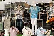 Street photo of men's store window display Bergenline Ave, West New York, NJ