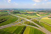 Nederland, Gelderland, Gemeente Zaltbommel, 27-05-2013; verkeersknooppunt Deil, A2 en A15 (vlnr) - rechts de Betuweroute. Klaverturbineknooppunt.<br /> Deil junction, main motorway A15 Rotterdam Harbour - Germany crossing A2 to the South.<br /> luchtfoto (toeslag op standard tarieven)<br /> aerial photo (additional fee required)<br /> copyright foto/photo Siebe Swart