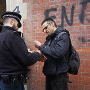 Activists protest outside the London School of Economics aganist extreme inequality and corruption at the school – a £100,000 cut in the Director's pay and the money to go to the lowest paid workers (for starters) and one arrested trying to paint the wall of LSE Old Building on 3rd May 2017, London, UK. by See Li