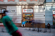 "A street perfomer dancing in-front of a souvenir shop called ""I love Prague"" at the street ""Na Mustku"" located on the lower end of Wenceslas Square in Prague."