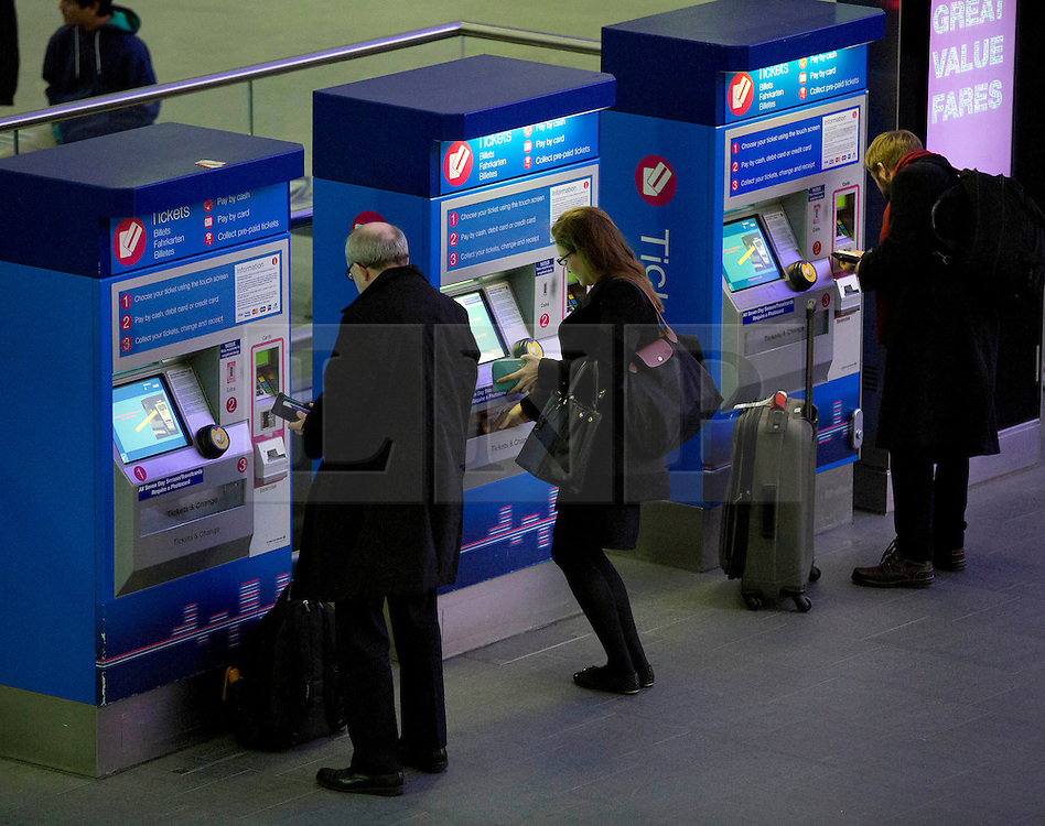 © Licensed to London News Pictures. 02/01/2014. London, UK. Commuters are seen buying tickets in Kings Cross Station today (02/01/2014) as the country deals with a new years rise in rail fares. Photo credit: Matt Cetti-Roberts/LNP