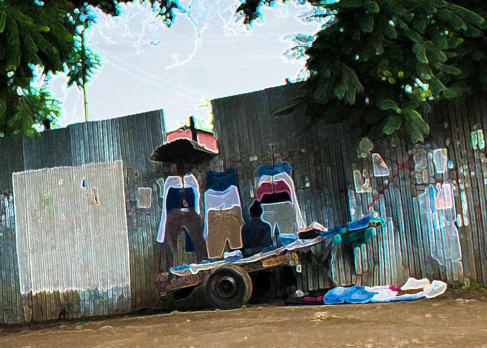 Peddlar in Arusha - cart, clothing