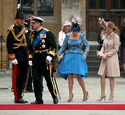 29 April 2011. London, England..Royal wedding day. Prince Andrew arrives with daughters Eugene and Beatirce at Westminster Abbey. .Photo; Charlie Varley.