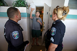 Hollywood Police officer Kenny Klingman and Sgt. Gina Aud speak to a resident at the Seahorse Condominium on Hollywood Beach about evacuating. The man who did not want to give his name said he was undecided about evacuating from his ocean front condo. The Hollywood police are creating lists of residents who have decided to remain on the beach even though its a mandatory evacuation zone. Hollywood police say they will check on those known individual after the storm passes. Photo by Susan Stocker/Sun Sentinel/TNS/ABACAPRESS.COM