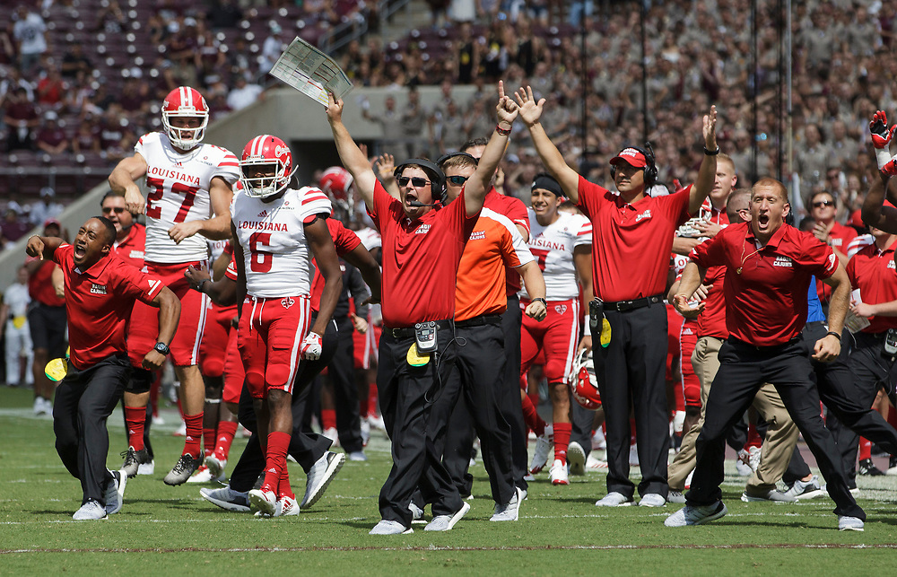 The Louisiana-Lafayette bench reacts after a second quarter touchdown run against Texas A&M of an NCAA college football game Saturday, Sept. 16, 2017, in College Station, Texas. (AP Photo/Sam Craft)