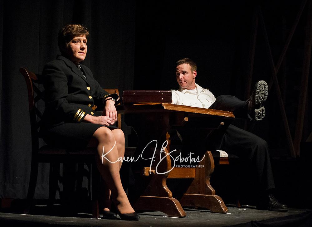 "Doreen Sheppard (Lieutenant Commander JoAnne Galloway) and Chris Fernandez (Lieutenant Daniel Kaffee) during dress rehearsal for Streetcar Company's production of ""A Few Good Men"" on Thursday evening at Laconia High School.  (Karen Bobotas/for the Laconia Daily Sun)"