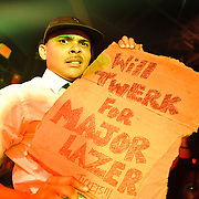 WASHINGTON, DC - October 26th, 2012 - Major Lazer hype-man MC Walshy Fire holds up a fan's handmade sign during the group's performance at the 9:30 Club in Washington, D.C.  The group, led by superstar DJ Diplo, plans on releasing their sophomore album in February 2013. (Photo by Kyle Gustafson / For The Washington Post)