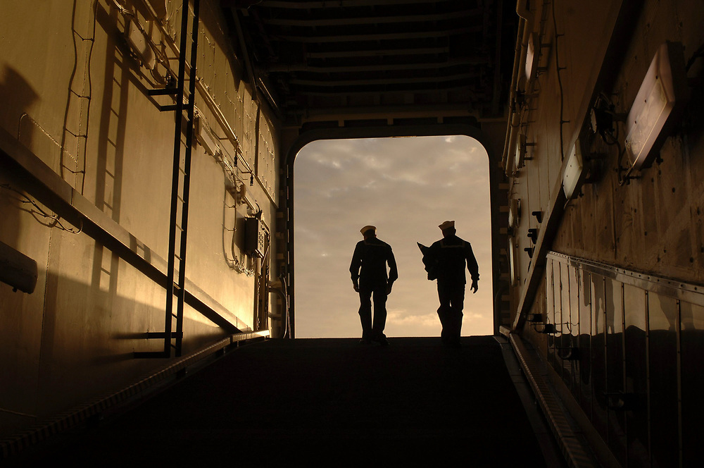 Port Aransas, TX January 15, 2006:    Early morning light catches sailors on routine duty about the ship. Maiden voyage of the USS San Antonio (LPD-17) amphibious transport dock after her commissioning ceremony 14Jan.  ©Bob Daemmrich /
