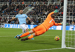 27 December 2017 Newcastle: Premier League Football - Newcastle United v Manchester City : Sergio Aguero of City puts the ball past Newcastle goalkeeper Rob Elliot but is offside.<br /> (photo by Mark Leech)