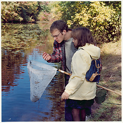 """Forestry Students in Field Study with New Haven Middle School Student. Yale School of Forestry & Environmental Studies. Viewbook Illustration. Comp files only: Contact Photographer for new high res scans from the original 2.25"""" square negative."""