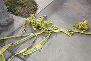Shooting in San Bernardino.<br /> Yellow police tape on the street in front of the shooters Redlands apartment building.