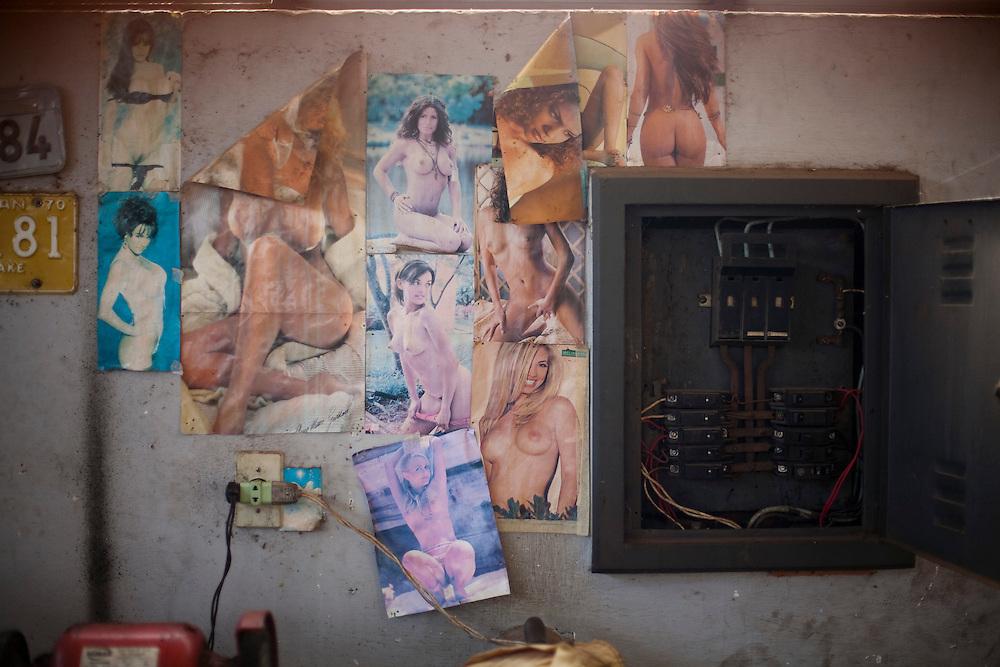 Nepomuceno_MG, Brasil...Detalhe de fotografias de mulheres nuas na parede de uma borracharia...Detail of naked women photos on the wall in the repair shop...Foto: LEO DRUMOND / NITRO
