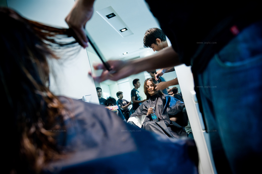 A young Indian woman gets her hair done at Looks, a luxury unisex salon in Khan market, New Delhi