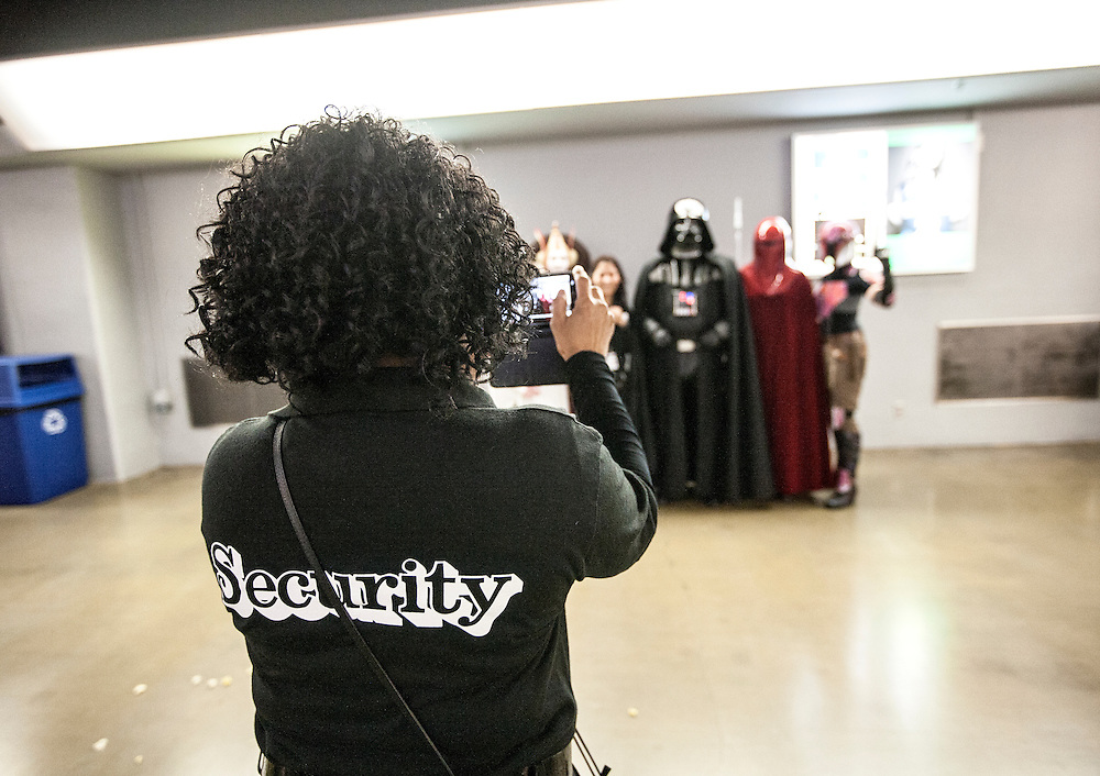 Security staff pause for a photo with characters at Star Wars night at the Timberwolves game at Target Center in Minneapolis December 15, 2015.