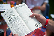 April 29, 2017, 22nd annual Queen's Cup Steeplechase. A fan reads the condition book for the third race.