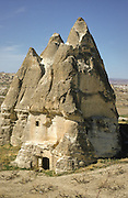 A tufa fairy tower dwelling in Cappadocia sculpted by wind and flood water. Turkey, 1993