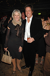 DAME HELEN MIRREN and HUGH GRANT at a reception to Discover Wilton's Music Hall held at the hall in Graces Alley, London E1 on 5th December 2007.<br /><br />NON EXCLUSIVE - WORLD RIGHTS