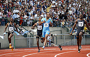 Justin Gatlin (right) defeats Asafa Powell in the 100 meters  in the 31st Prefontaine Classic, Saturday, June 4, 2005, in Eugene, Ore.  Gatlin and Powell were each timed in a wind-aided 9.84. Shawn Crawford (14) places fourth in 9.98 and Kim Collins (17) places fifth in 10.02.