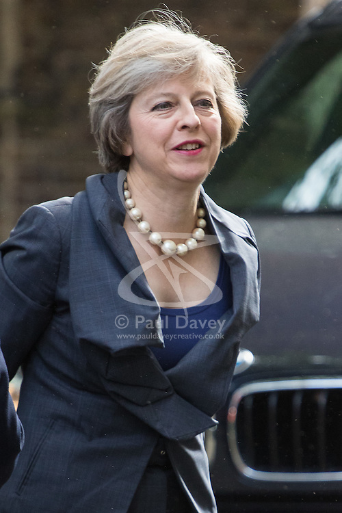 Home Secretary Theresa May arrives at David Cameron's final cabinet meeting as she prepares to take over as the new British Prime Minister.