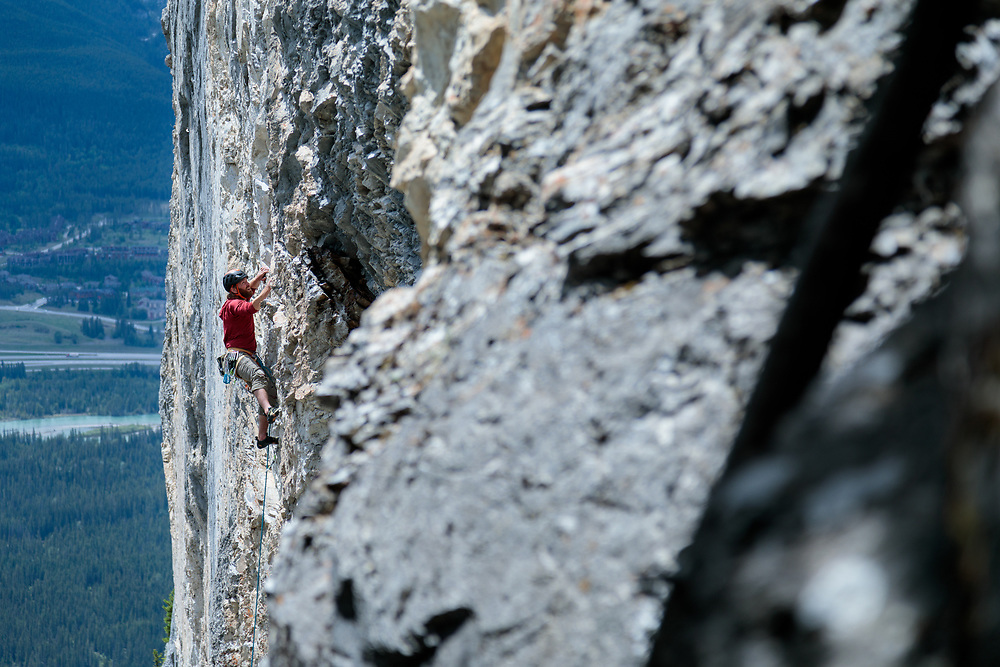 Max Fisher leading Blood Line, 5.11a at Bataan, Canmore, Alberta