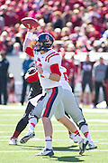 Oct 27, 2012; Little Rock, AR, USA; Ole Miss Rebels quarterback Bo Wallace (14) looks to make a pass during a game against the Arkansas Razorbacks at War Memorial Stadium. Ole Miss defeated Arkansas 30-27. Mandatory Credit: Beth Hall-US PRESSWIRE