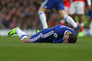 Eden Hazard of Chelsea lies injured after being fouled by Gabriel of Arsenal. Premier league match, Chelsea v Arsenal at Stamford Bridge in London on Saturday 4th February 2017.<br /> pic by John Patrick Fletcher, Andrew Orchard sports photography.